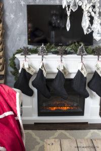 black stocking hung on white fireplace