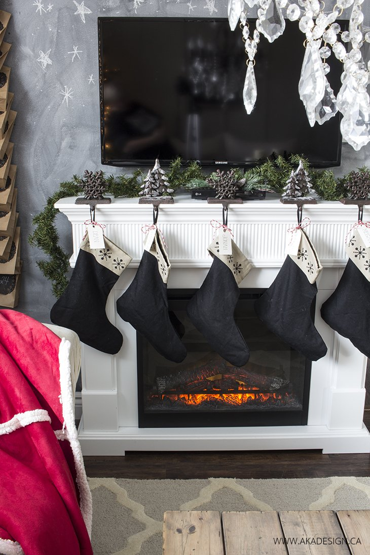 black stocking hung on white fireplace