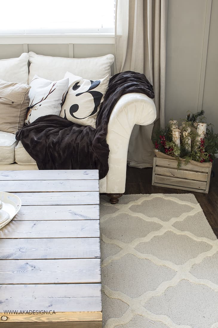 cream trellis rug white couch board and batten walls
