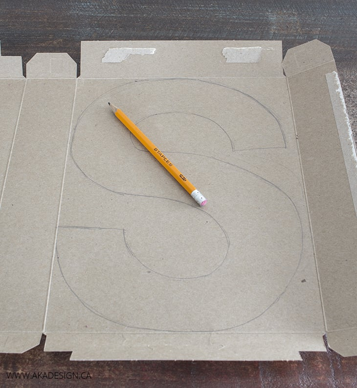 Draw a letter on cardboard