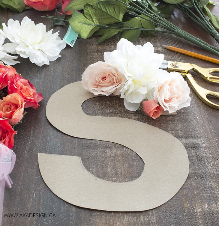 make a monogram from faux flowers and cardboard