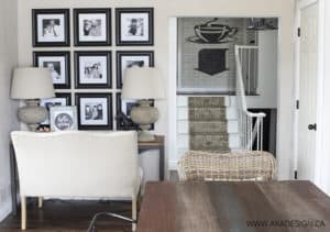 X base desk settee black and white picture wall