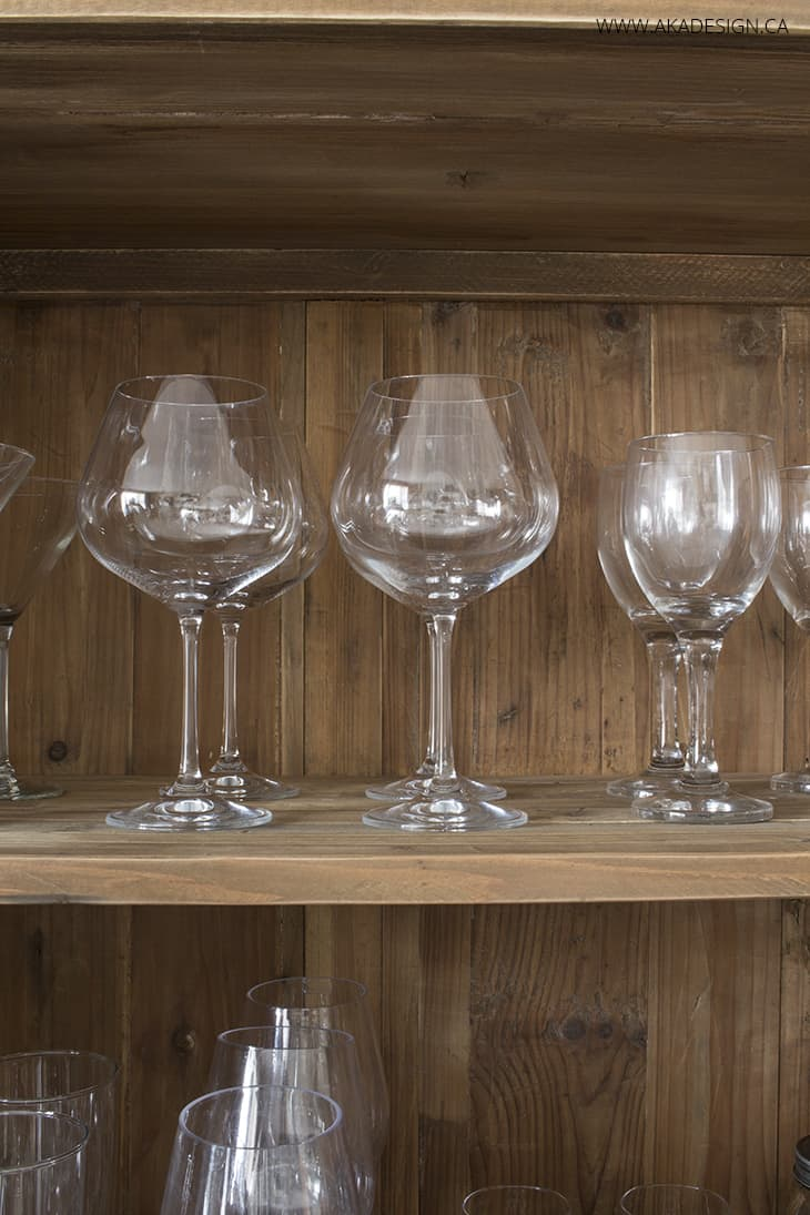 interior of dining room bookcase with glasses