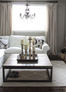 Living room angle with chandelier centered