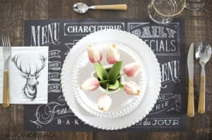 chalkboard place mat, wooden utensils, pink tulips, stag head napkin