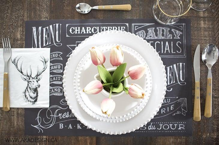 chalkboard place mat, wooden utensils, pink tulips, stag head napkin