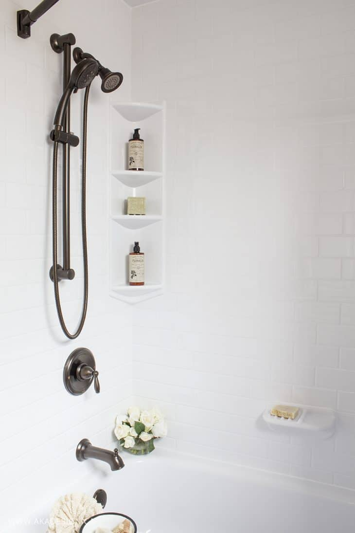 White Bath Tub and Surround Oil Rubbed Bronze Hardware