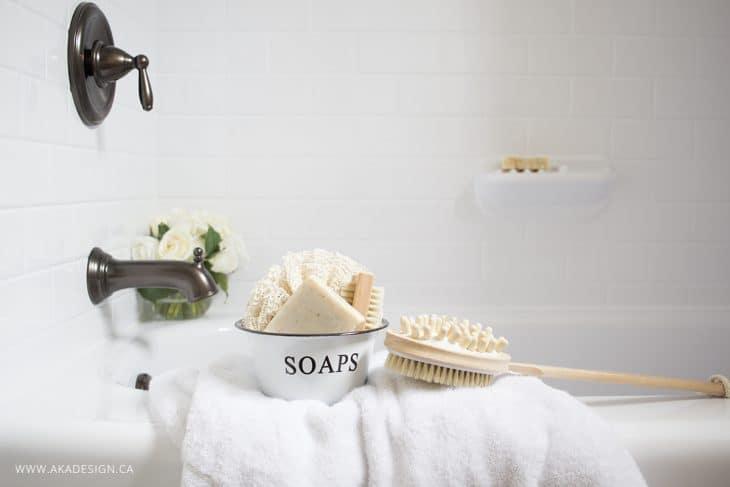 White bath tub subway tile surround farmhouse accents