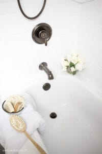 White tub, oil rubbed bronze fixtures, farmhouse accents