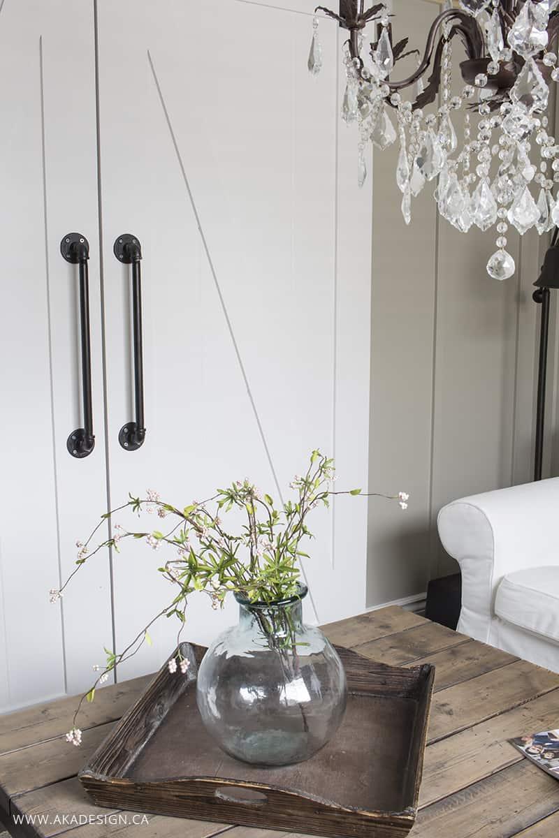white barn doors black hardware, chandelier