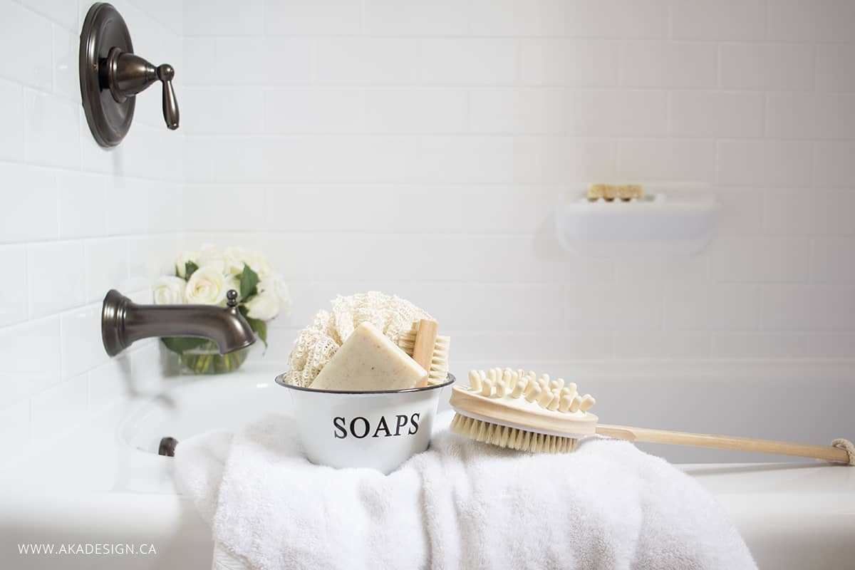 White bath tub subway tile surround farmhouse accents