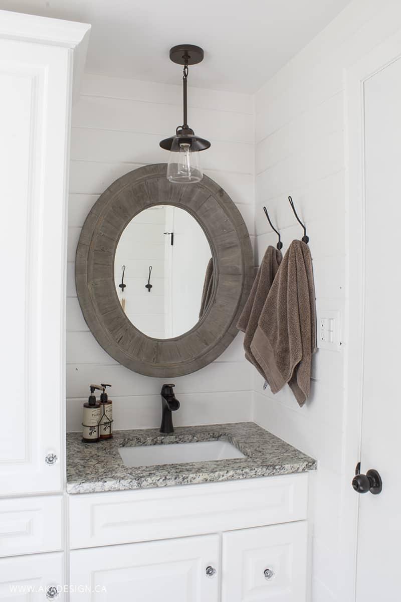 bathroom vanity and oval mirror