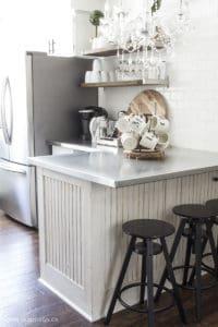 breakfast bar black stools chandelier