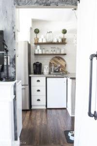white kitchen breakfast bar stainless steel fridge
