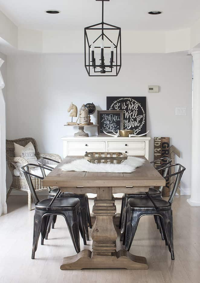 open white dining room with farmhouse table and chairs