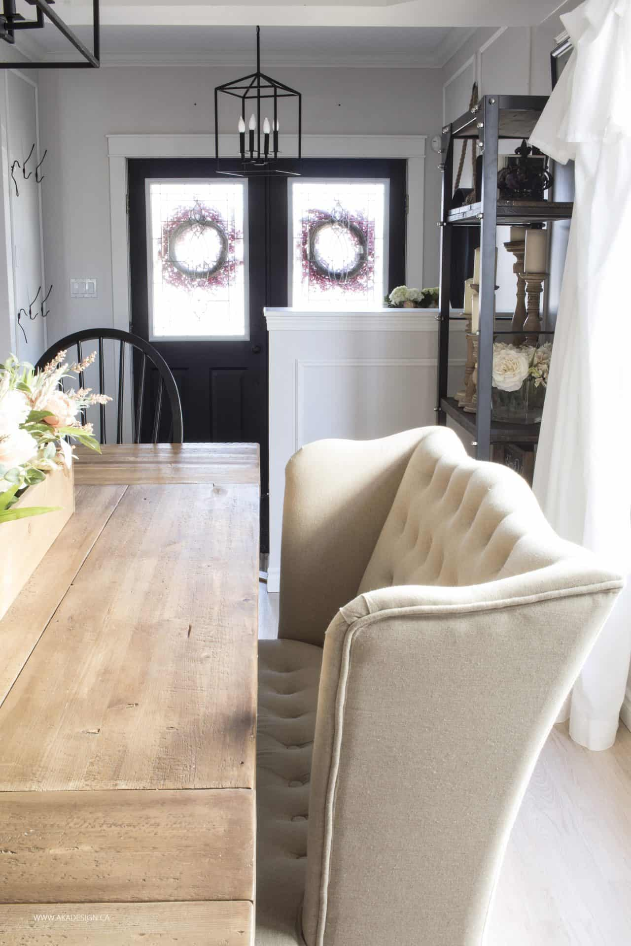 farmhouse style dining room looking to entry with black painted doors