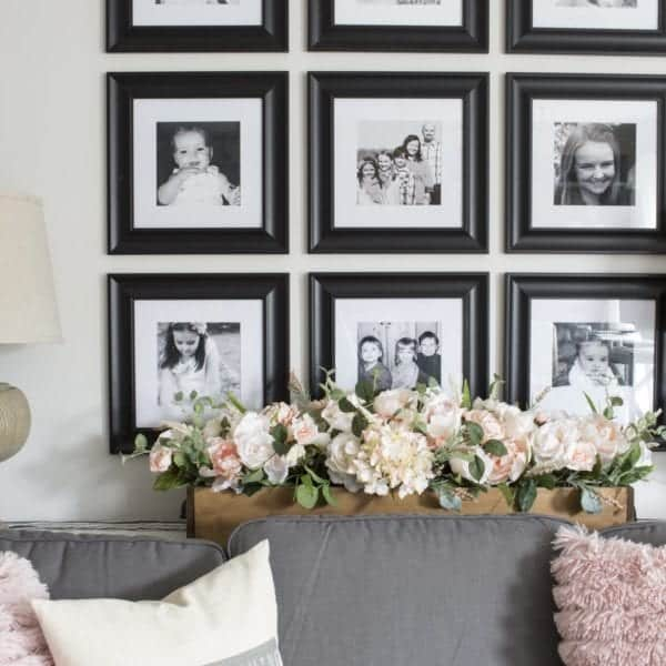 gallery wall, black and white, pink flowers