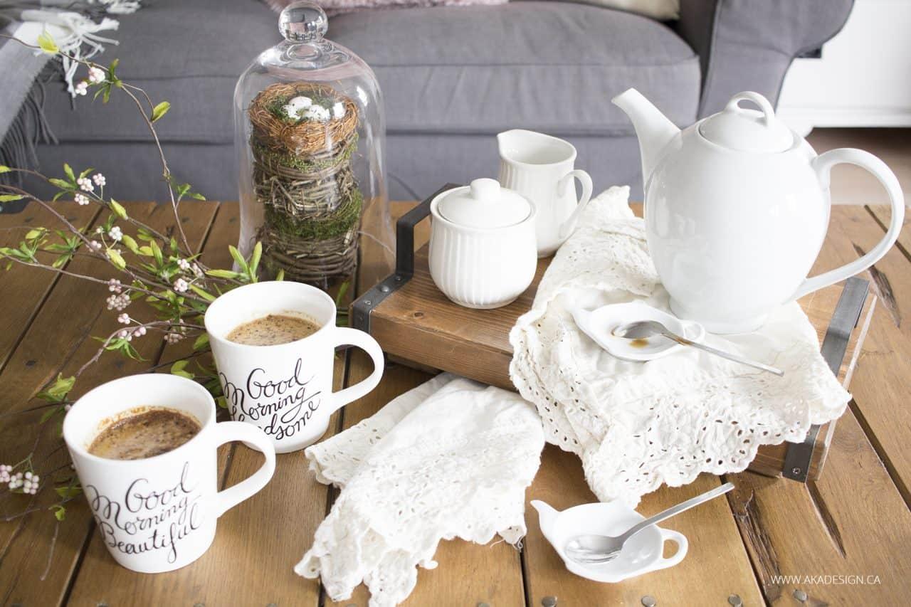 white tea pot and mugs on factory cart