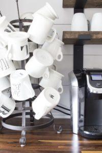anthropologie rea dunn mugs on bottle drying rack