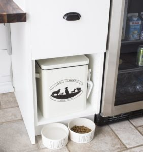 dog food bowls and food storage in cupboard