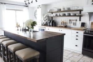 farmhouse style kitchen   open shelves   black island