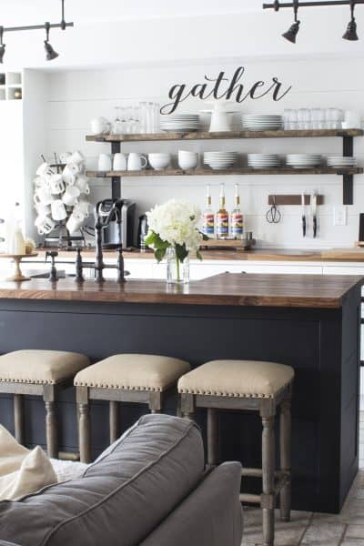white shiplap kitchen | butcher block counters | black island