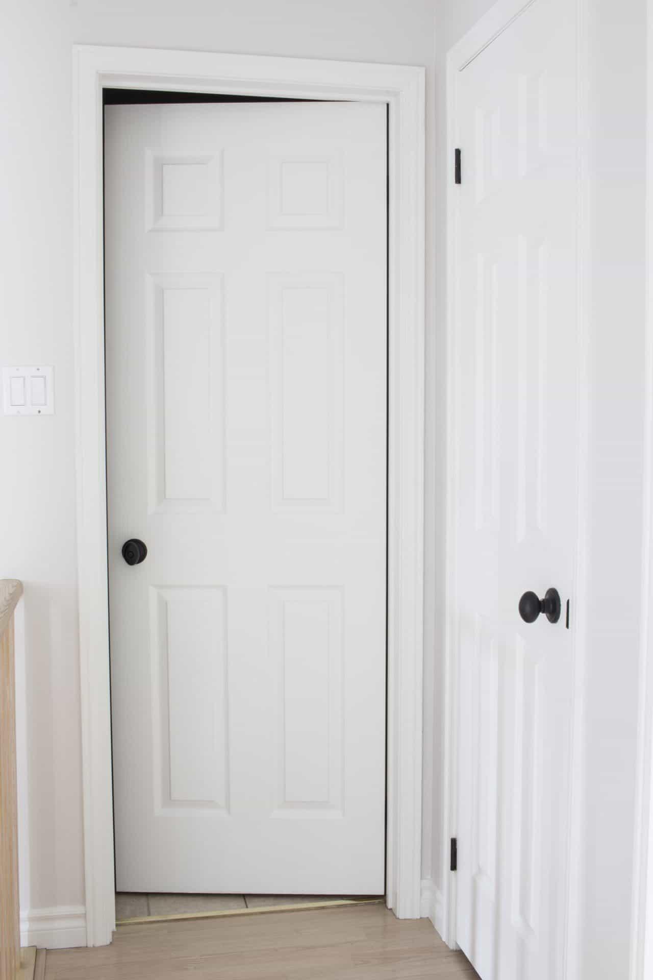AKA Design white doors black door knobs