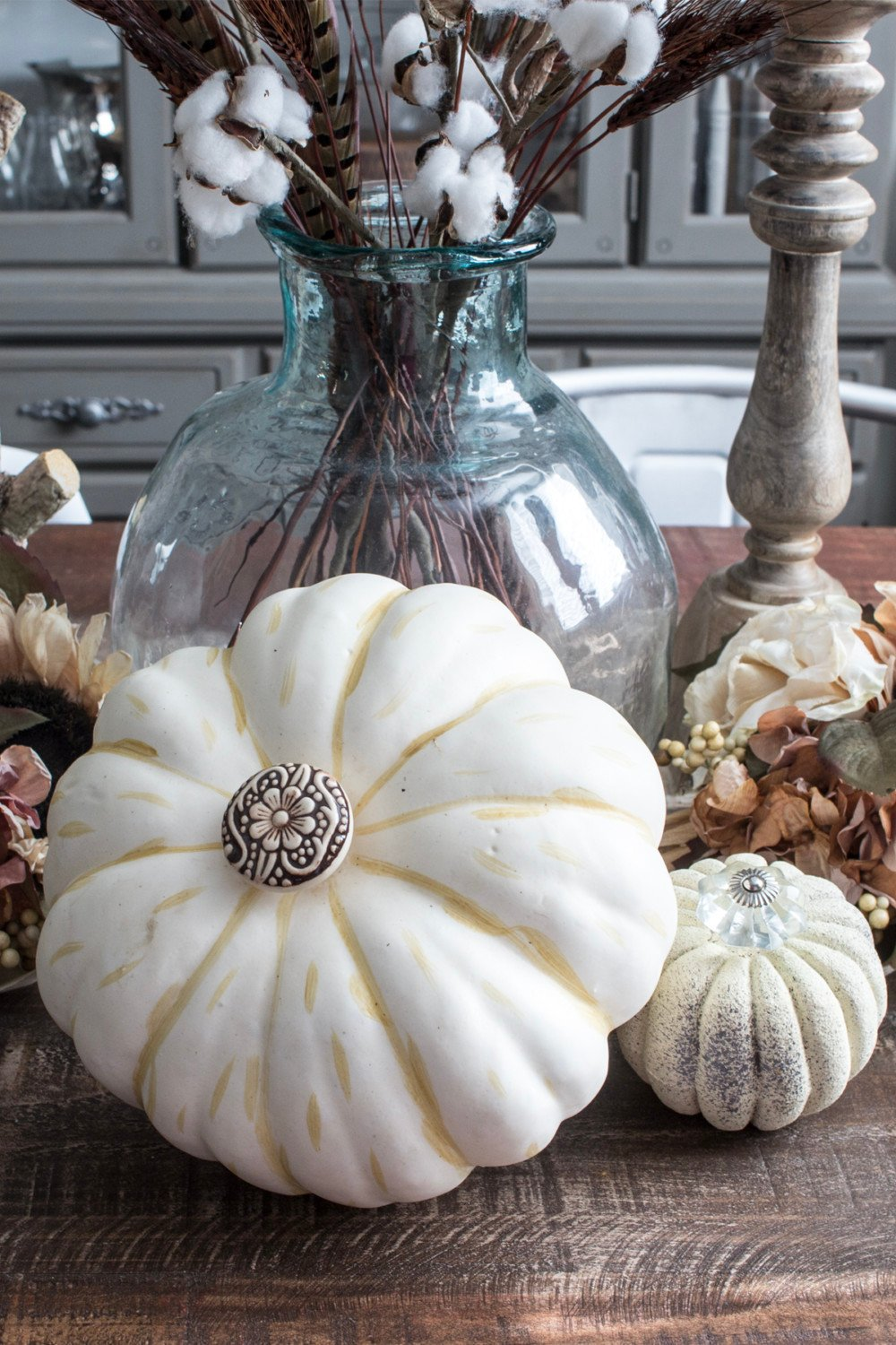 fancy faux pumpkins on dining room table