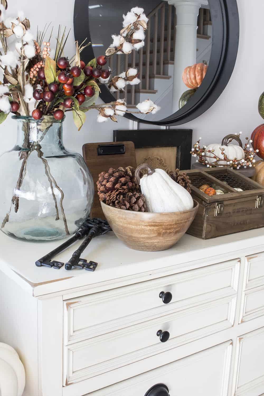 faux berries, cotten stems, wood bowls, white pumpkins