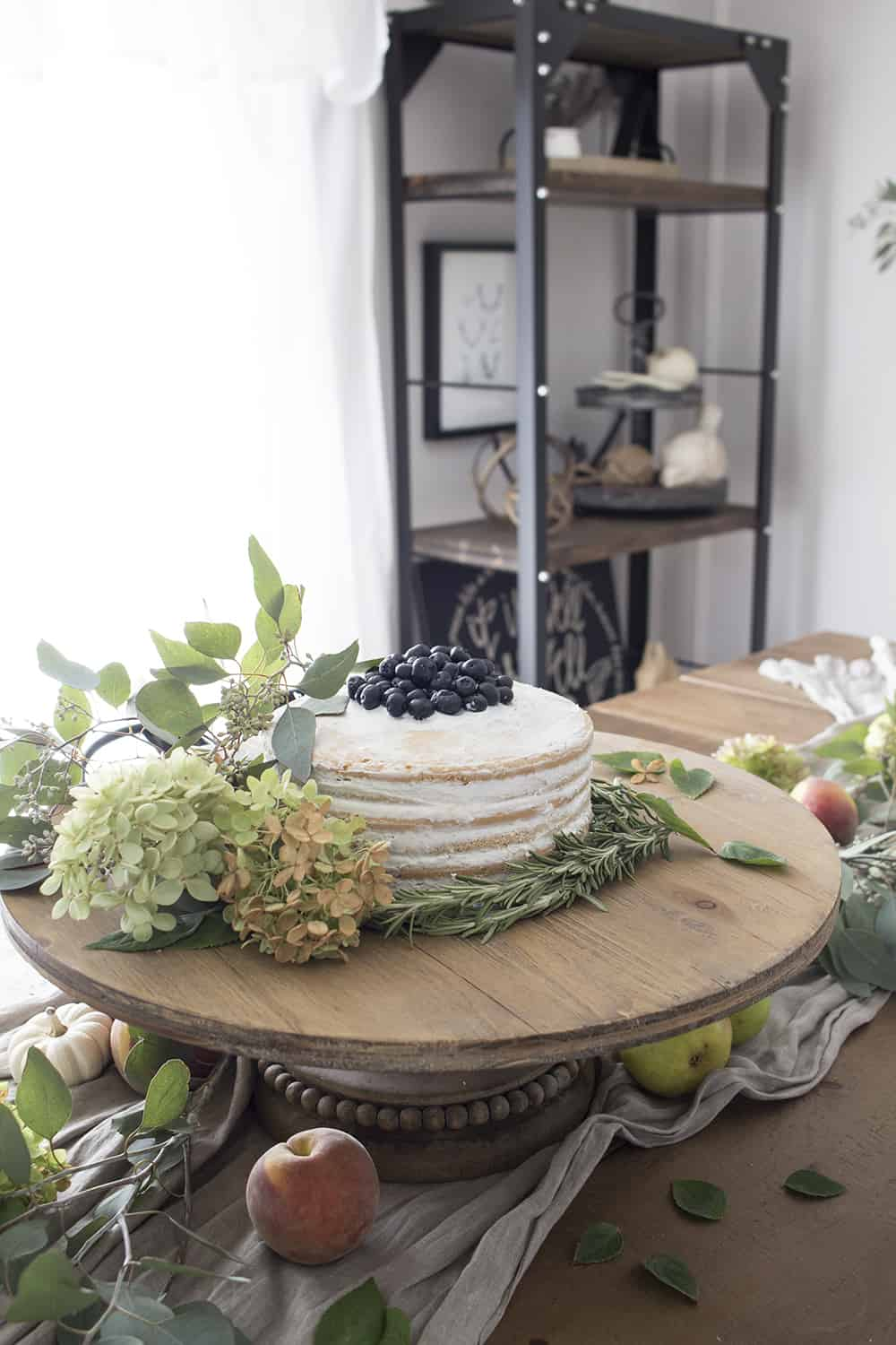 naked cake on wood cake stand