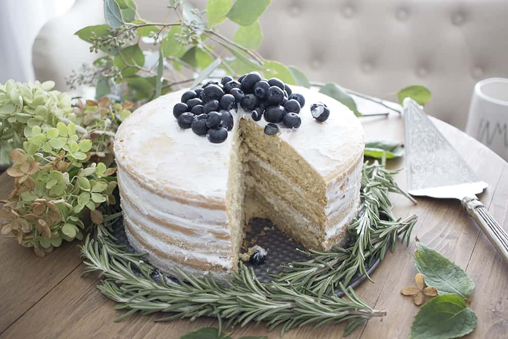 naked cake with blueberries and rosemary