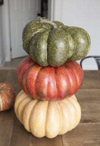 three faux pupmkins stacked