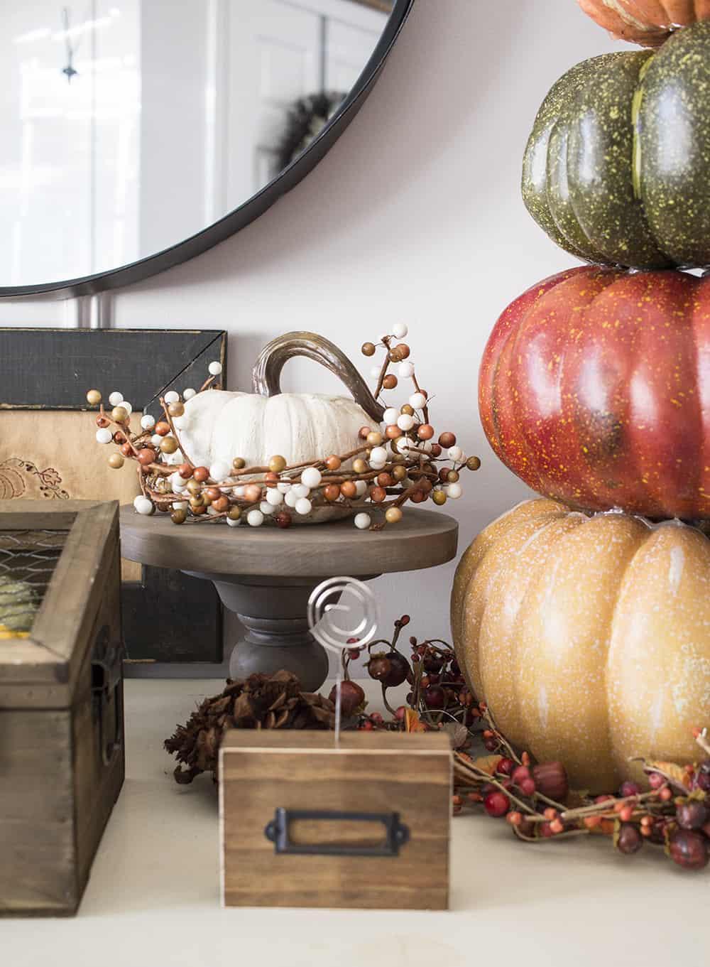 white pumpkin on cake stand