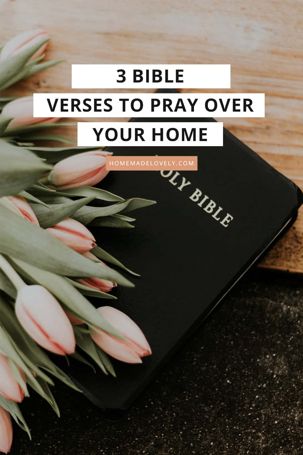 bible on wood table with pink tulips with text overlay that says 3 bible verses to pray over your home