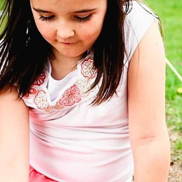 Brunette child playing outside
