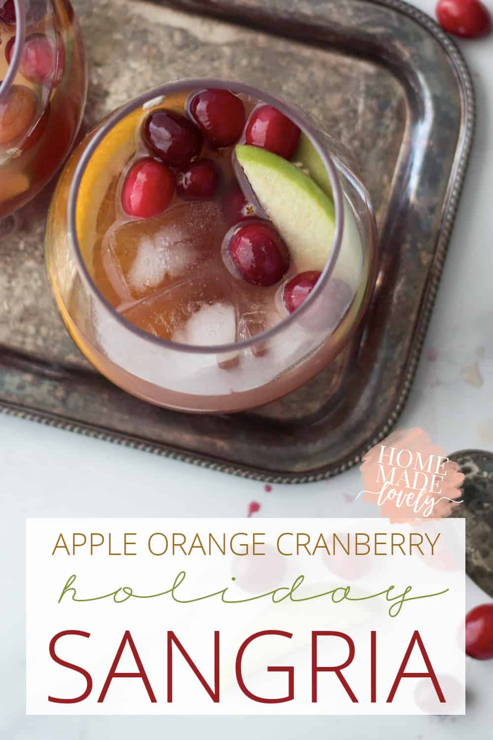 This apple orange cranberry holiday sangria is the perfect mix of fruit and spices for the winter months! Make up a pitcher & have it ready to serve guests!