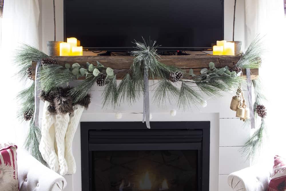 shiplap fireplace barn beam mantel tv above christmas