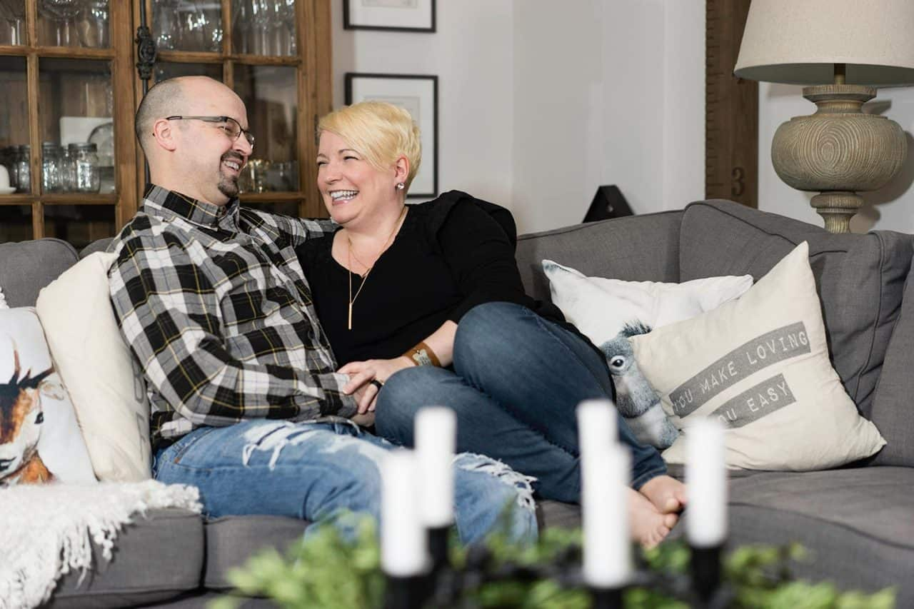 Dean and Shannon Acheson laughing on couch