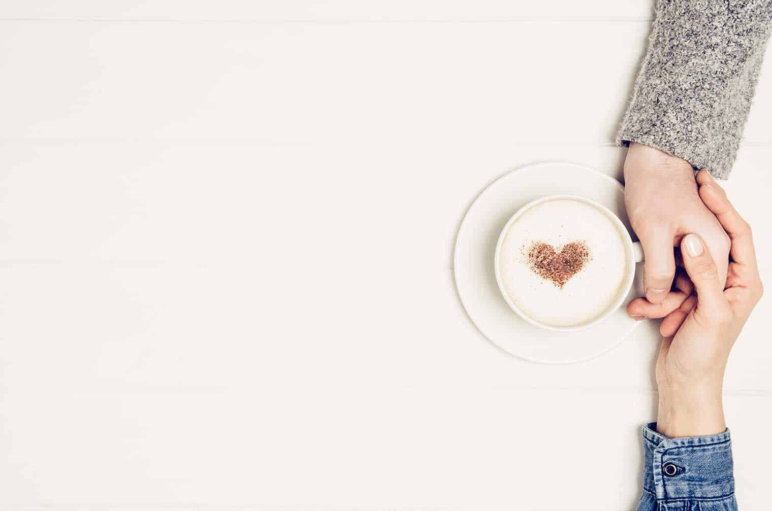 romantic date ideas, photo of coffee mug and couple holding hands