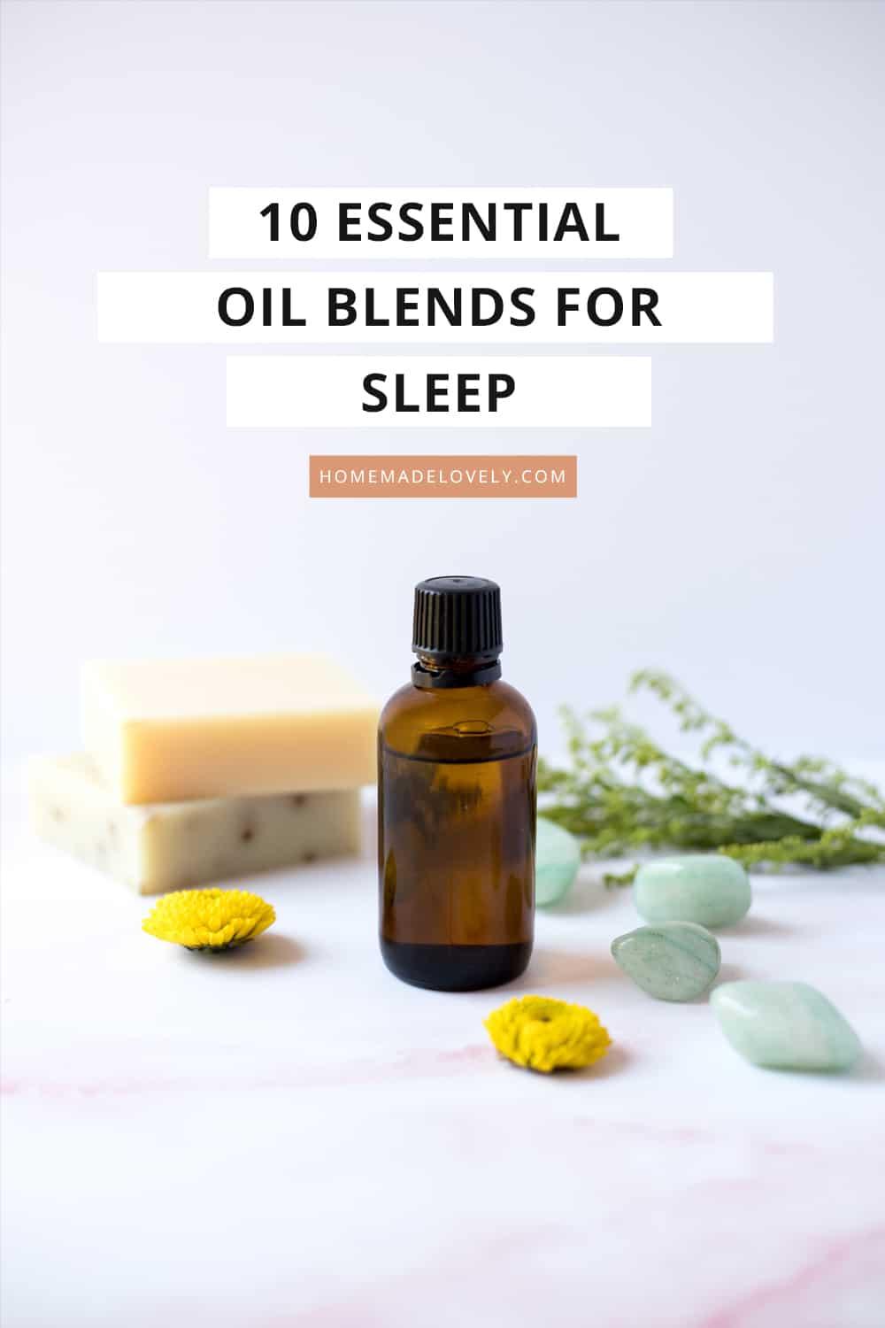 amber bottle with herbs and flower petals with text overlay that says 10 essential oil blends for sleep