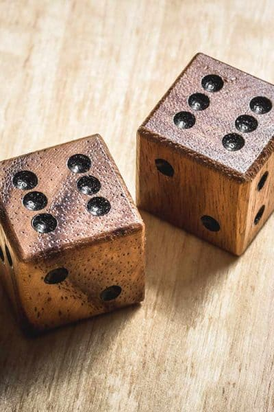two wood die with black dots