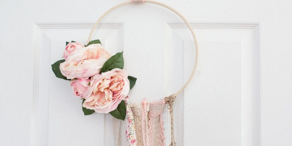 floral boho spring hoop wreath hanging on white closet door