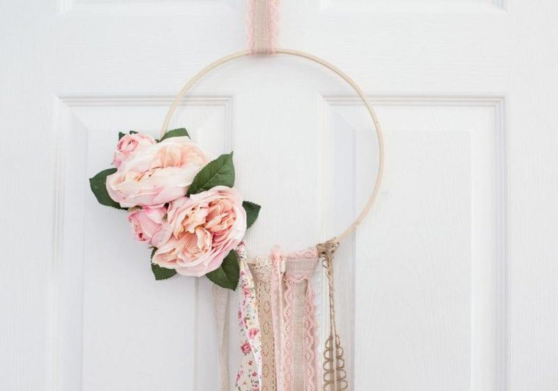 floral boho spring hoop wreath hanging on white closet door
