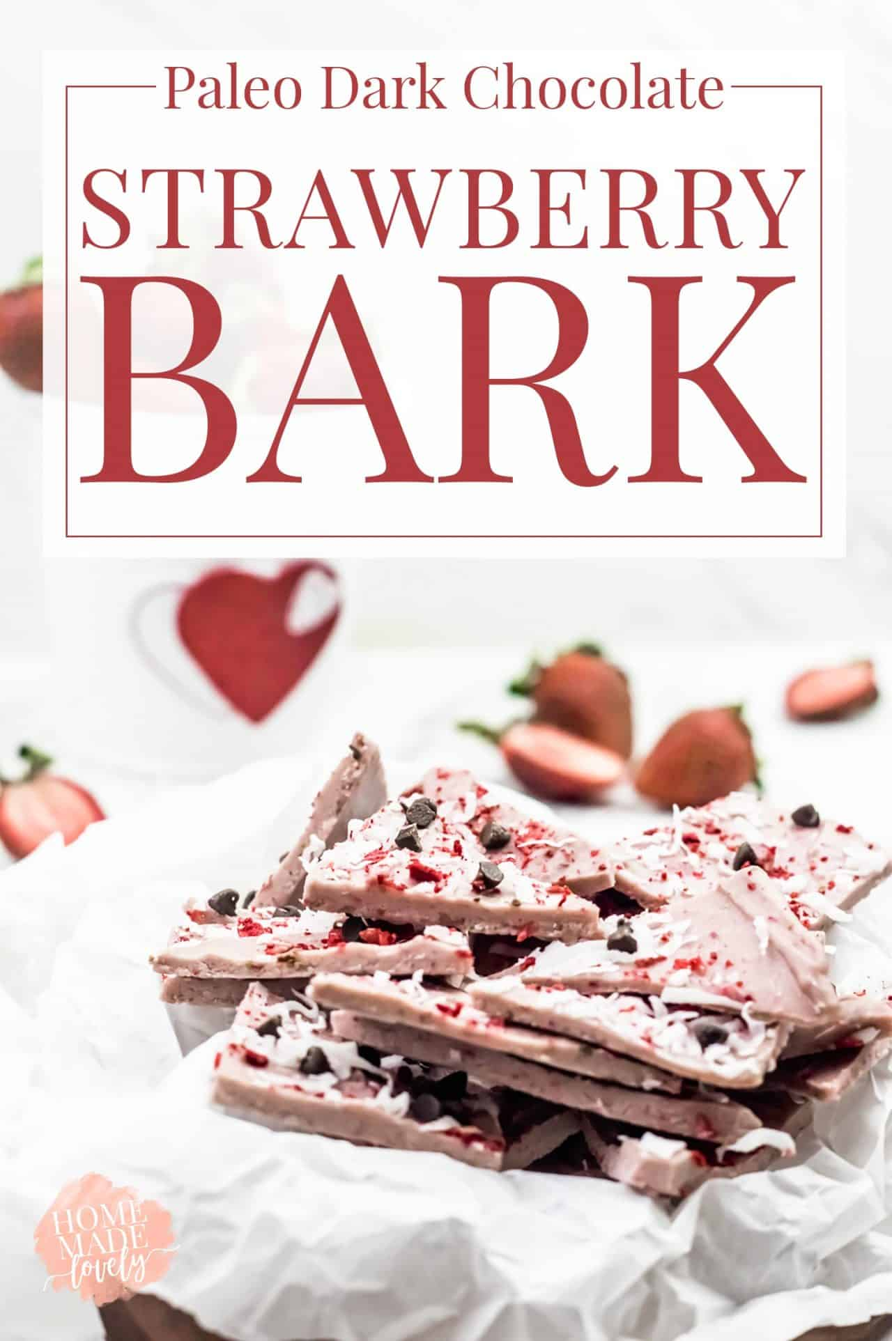 paleo dark chocolate strawberry bark stacked on a white paper dish
