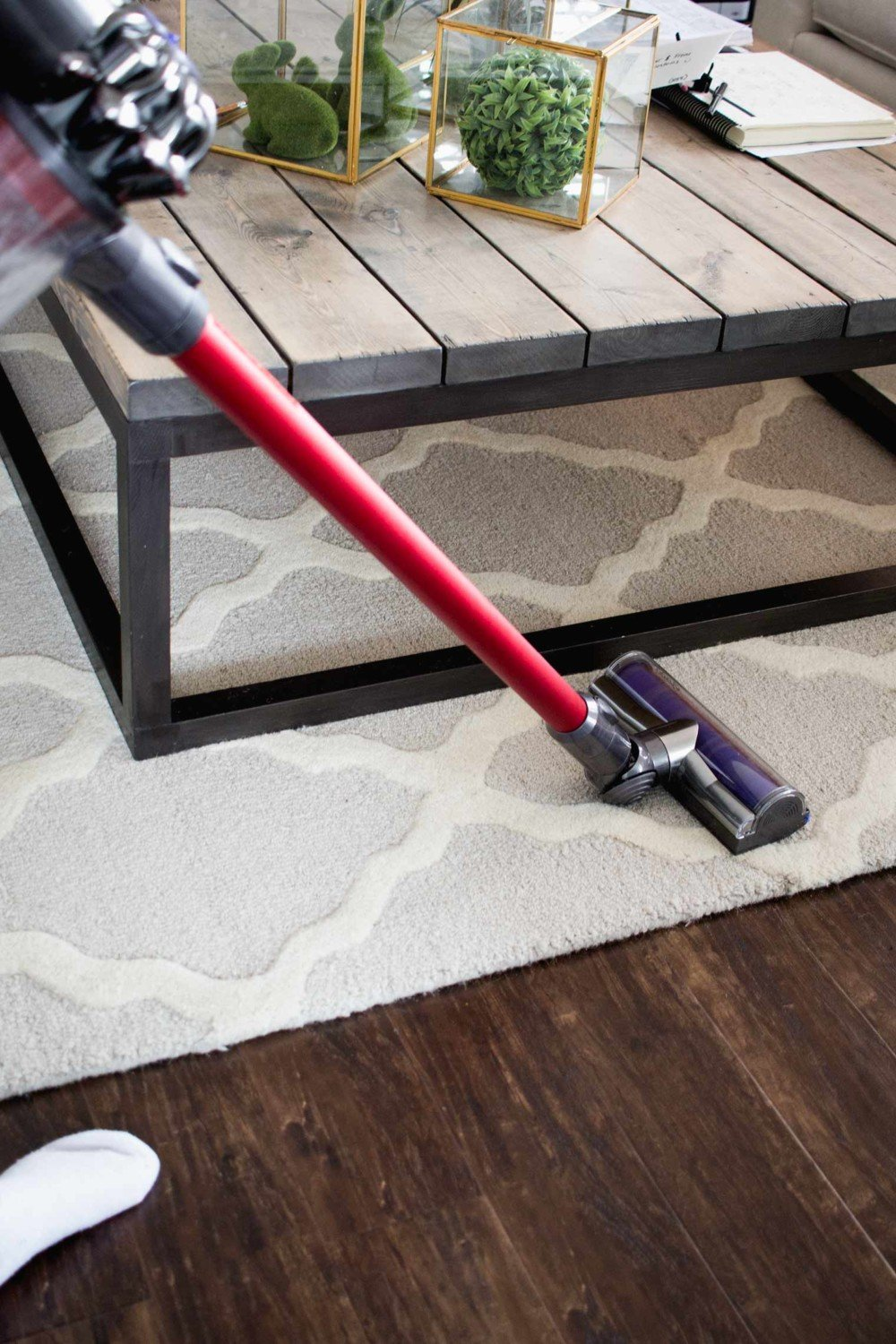 homemaker vacuuming rug