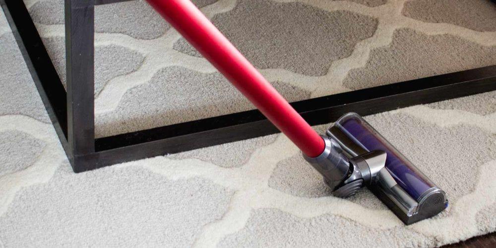 homemaker vacuuming rug