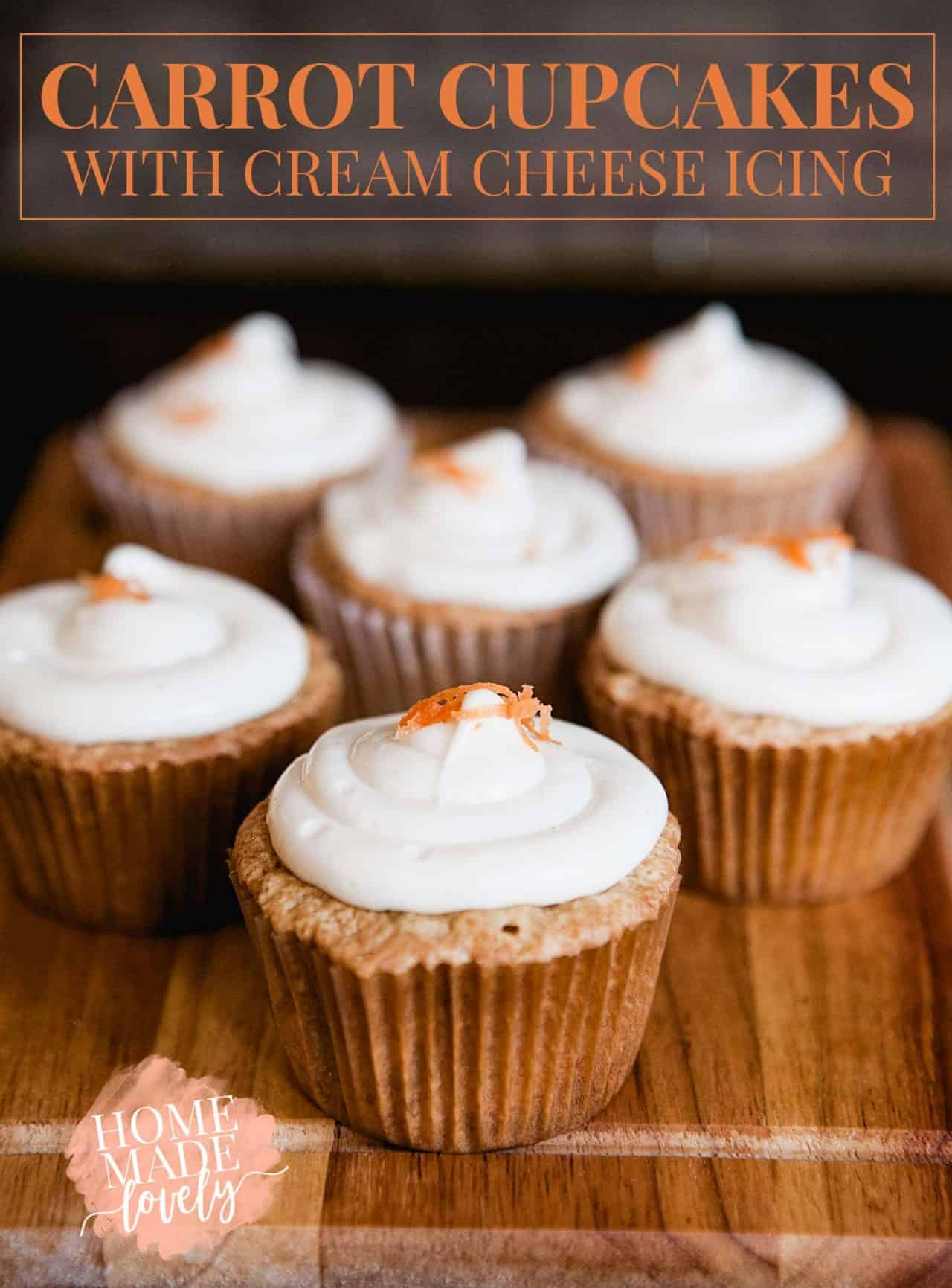 carrot cupcakes with cream cheese icing and carrots