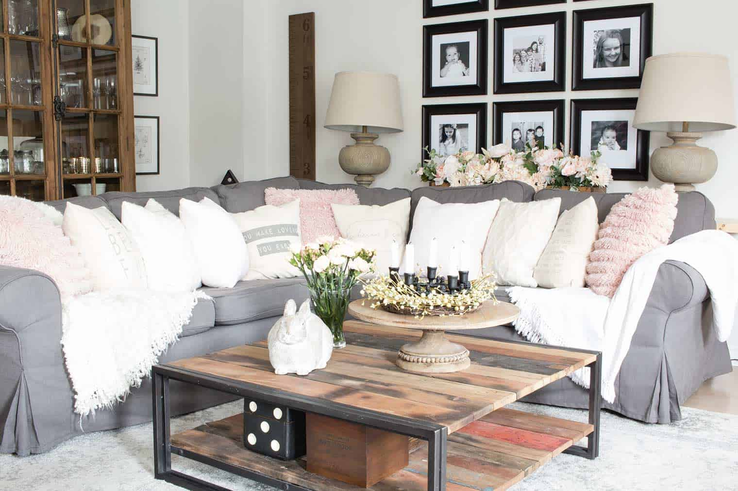 Farmhouse style living room sectional with blush and neutral pillows for Spring.