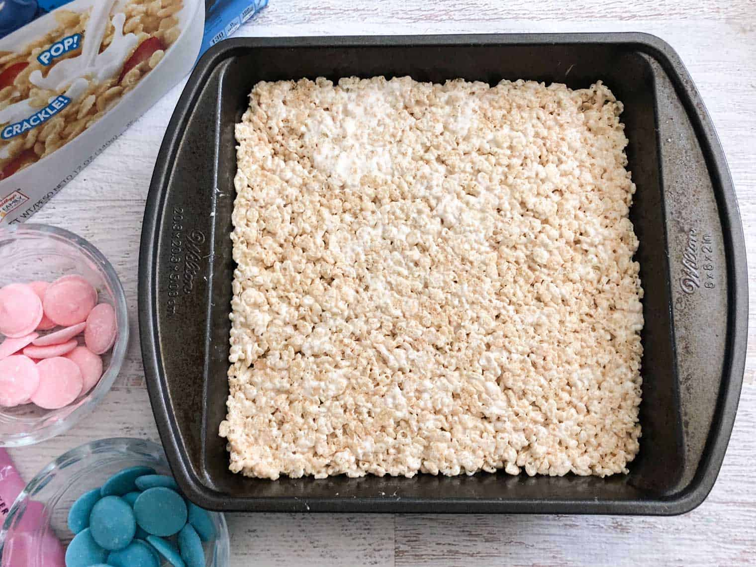 flatten rice krispies mixture into a cake pan and freeze