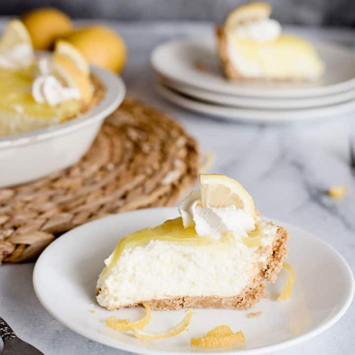 lemon cream pie slice on a place with pie in background